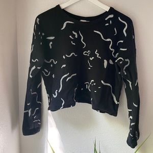 Cropped black sweatshirt with white squiggles